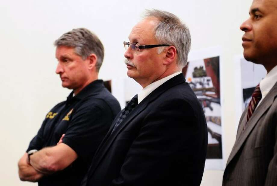 From left: Seattle Police Department Assistant Chief Jim Pugel, Chief John Diaz and FBI agent Steven Dean at an April 2012 press conference. (Lindsey Wasson/seattlepi.com)