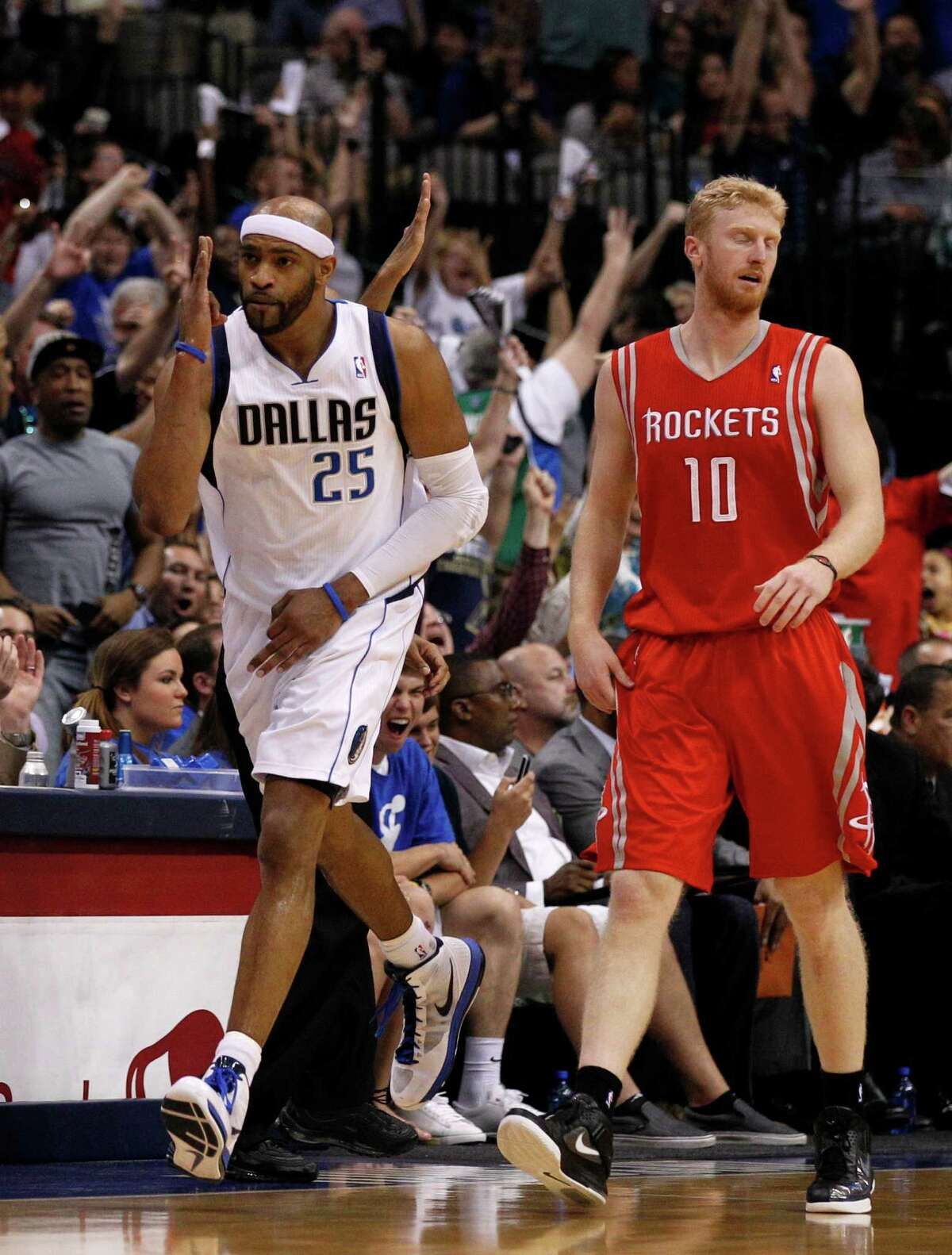 Dallas Mavericks' Vince Carter (25) celebrates a three-point basket in front of Houston Rockets' Chase Budinger (10) late in the second half of an NBA basketball game on Wednesday, April 18, 2012, in Dallas. The Mavericks won 117-110.