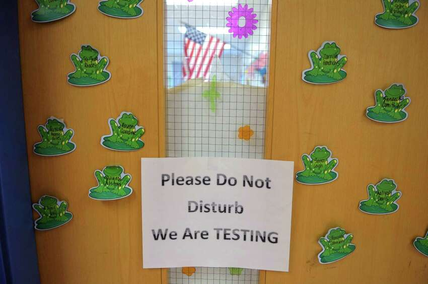 A sign on the door of a third grade class as students in grades 3 through 8 take the state standardized tests at Sheridan Prep Academy on Wednesday, April 18, 2012 in Albany, NY. (Paul Buckowski / Times Union)