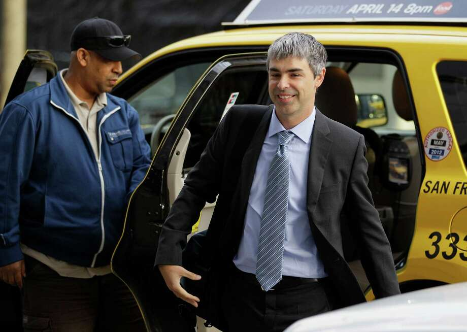 Google's Larry Page arrives Wednesday to testify in his company's battle with Oracle over patents. Photo: Eric Risberg / AP