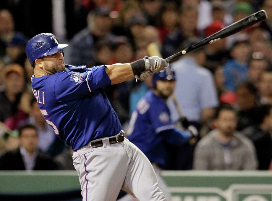 Rangers catcher Mike Napoli shows off his power stroke on a two-run homer in the fourth inning of Wednesday night's 6-3 win over the Red Sox in Boston. Photo: Elise Amendola / AP