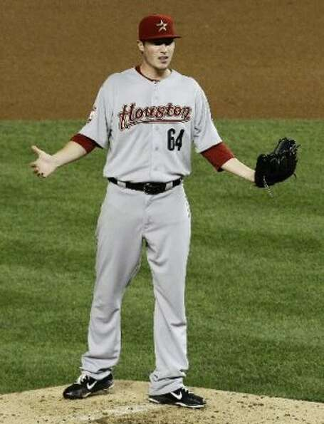 Lucas Harrell disagrees with the call on his balk. (Ann Heisenfelt / AP)
