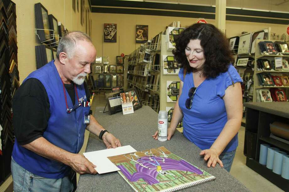 William Carey Jones helps customer Nataliya Chernis in the Hobby Lobby framing department in the Meyerland area. Chernis was having an original pastel by her daughter framed for an art show. Photo: Gary Fountain / Copyright 2012 Gary Fountain.