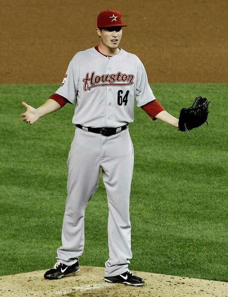Astros starter Lucas Harrell disputes a balk call in the sixth inning. Photo: Ann Heisenfelt / FR13069 AP