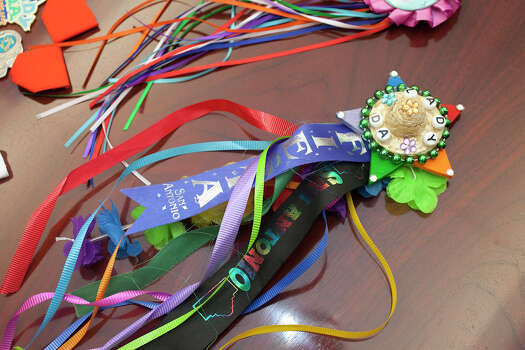 District Attorney Susan Reed's collection of Fiesta medals includes this handmade medal made for her that someone gave her on the street, as seen in her office, Wednesday, April 11, 2012. Photo: J. Michael Short , For The Express-News / THE SAN ANTONIO EXPRESS-NEWS