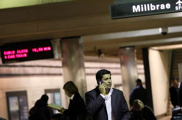 Jose Castillo of Orange County uses his phone while awaiting his train. BART cut off cell service Aug. 11 to quash a protest, Photo: Sarah Rice, Special To The Chronicle