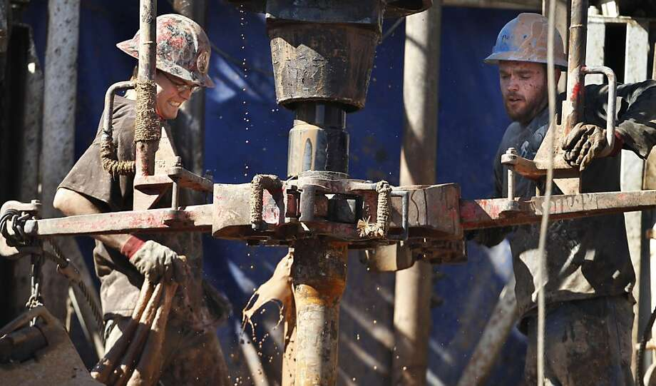 "In this Tuesday, Feb. 21, 2012 photo, oil field workers drill into the Gypsum Hills near Medicine Lodge, Kan. An emerging oil boom has been sparked by modern technologies using horizontal drilling and a technique known as hydraulic fracturing, or ""fracking,"" to coax out oil and gas. The potential production from the Mississippian Lime formation here - and its impact on domestic energy supplies - remains uncertain. But the use of the technology to unlock energy supplies previously unavailable in the United States is now in play in places like Pennsylvania, Wyoming, Colorado, New Mexico, Texas, Oklahoma and Louisiana. Photo: Orlin Wagner, Associated Press"