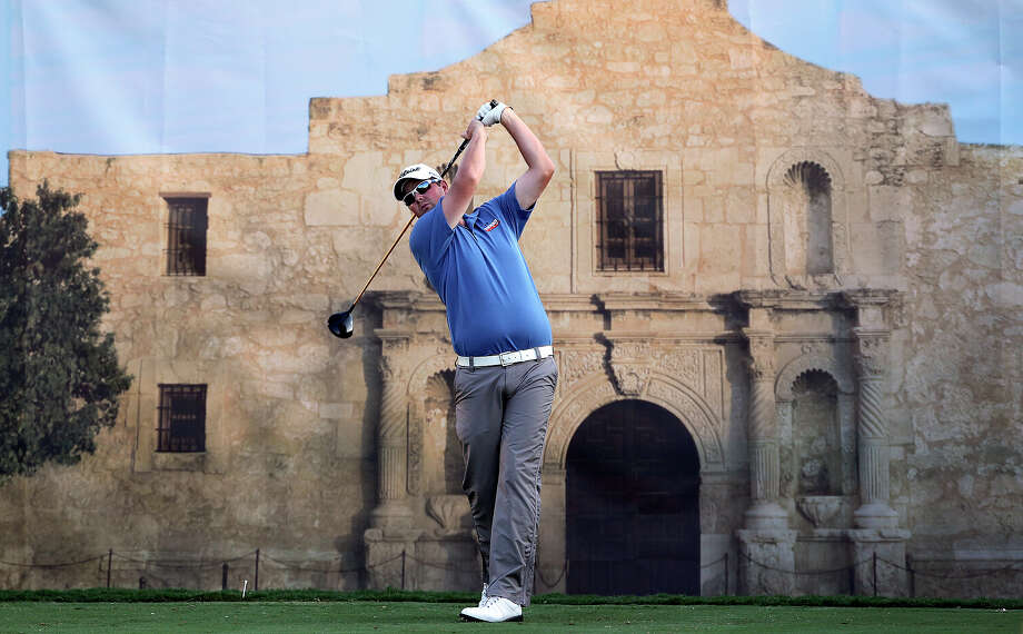 Marc Leishman tees in front of an Alamo mural at 18 during the Oak Farms Dairy Pro-Am  at the TPC Oaks Course on  April 18, 2012.  Tom Reel/ San Antonio EXpress-News Photo: TOM REEL, Express-News / San Antonio Express-News