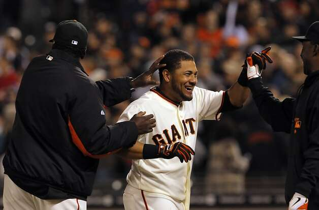 Melky Cabera celebrates after his game-winning single in the bottom of the eleventh. The San Francisco Giants defeated the Philadelphia Phillies 1-0 in 11 innings on a Melky Cabrera single that scored Brandon Belt on Wednesday, April 18, 2012, at AT&T Park in San Francisco, Calif. Photo: Carlos Avila Gonzalez, The Chronicle