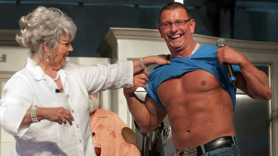 Celebrity Chef Paula Deen, left, jokes with Chef Robert Irvine Saturday, Feb. 27, 2010 at the South Beach Wine and Food Festival on the beach in Miami Beach, Fla.. Photo: Anonymous, AP / AP2010