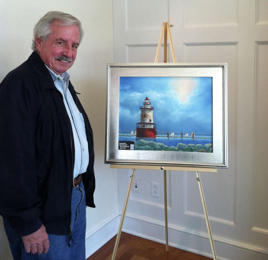 Steve Fritch stands next to one of his pieces, ìStamford Lighthouse.î Photo: Contributed Photo