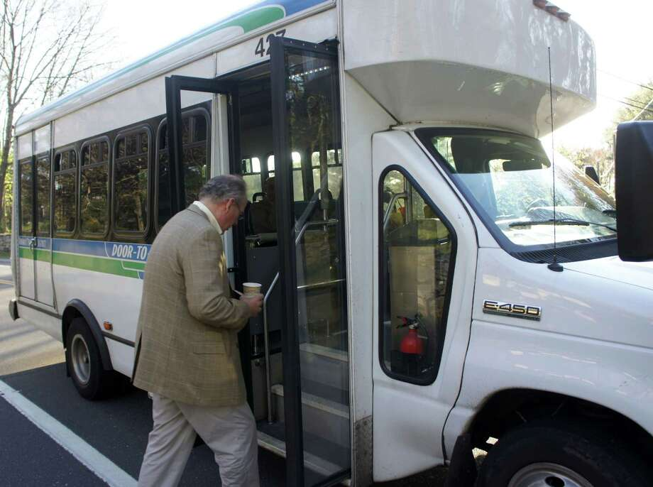 Jim Ross boards the Norwalk Transit District S4 commuter shuttle to the Saugatuck Metro-North train station at approximately 7:35 a.m. each day at the corner of Hillspoint Road and Hillandale Road. Photo: Paul Schott / Westport News
