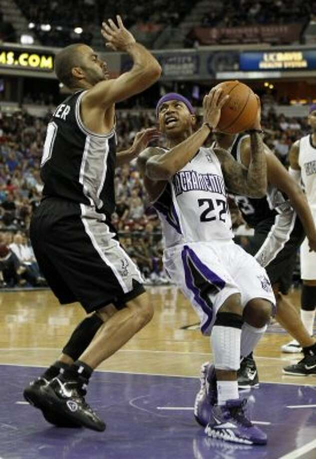 San Antonio Spurs guard Tony Parker, left, defends against Sacramento Kings guard Isaiah Thomas during the second half of an NBA basketball game in Sacramento, Calif., Wednesday, April 18, 2012.  The Spurs won 127-102.(AP Photo/Rich Pedroncelli) (AP)