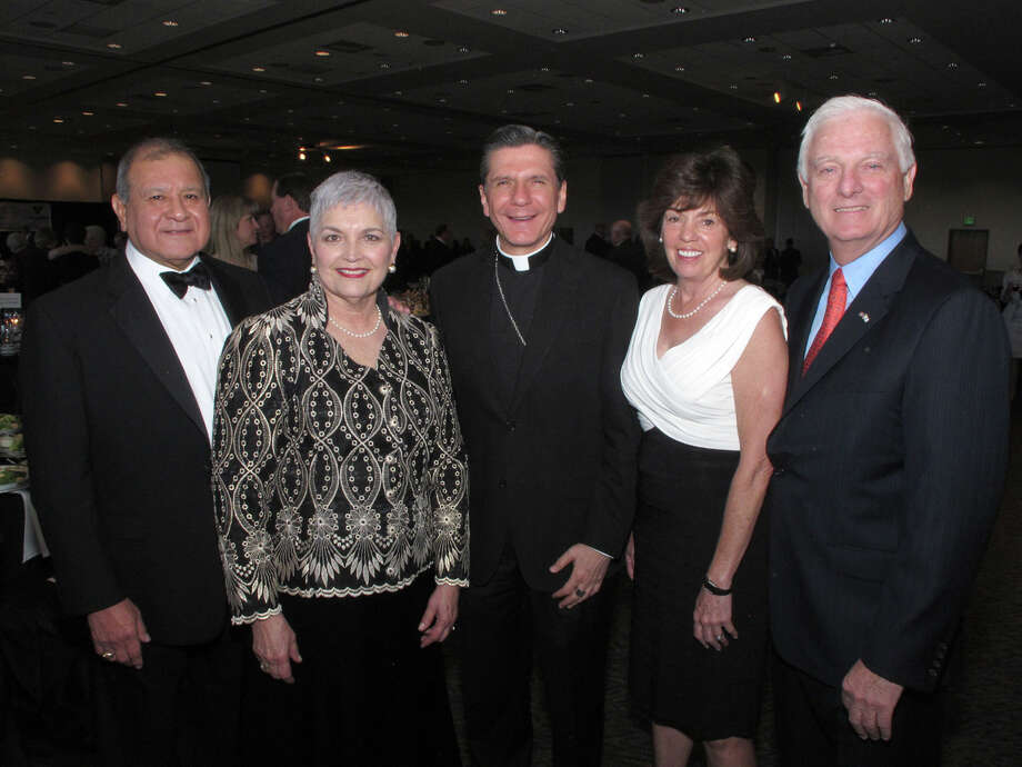 OTS/HEIDBRINK - Honorees and spouses Ruben Escobedo and Veronica Salazar Escobedo and Archbishop Gustavo Garcia-Siller M.Sp.S. and representing sponsors and spouses Margie Klesse and Bill Klesse gather at the Catholic Charities, Archdiocese of San Antonio gala at the University of the Incarnate Word on 4/11/2012. This is #1 of 2 photos. names checked photo by leland a. outz Photo: LELAND A. OUTZ, SPECIAL TO THE EXPRESS-NEWS / SAN ANTONIO EXPRESS-NEWS
