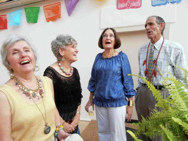 Marie Ann Smith, from left, shares a laugh with Doris Walsh, Kathleen Garrison and Richard Tietz at the Opera Guild's spring fundraiser at the Navarro House. Photo: NANCY COOK-MONROE