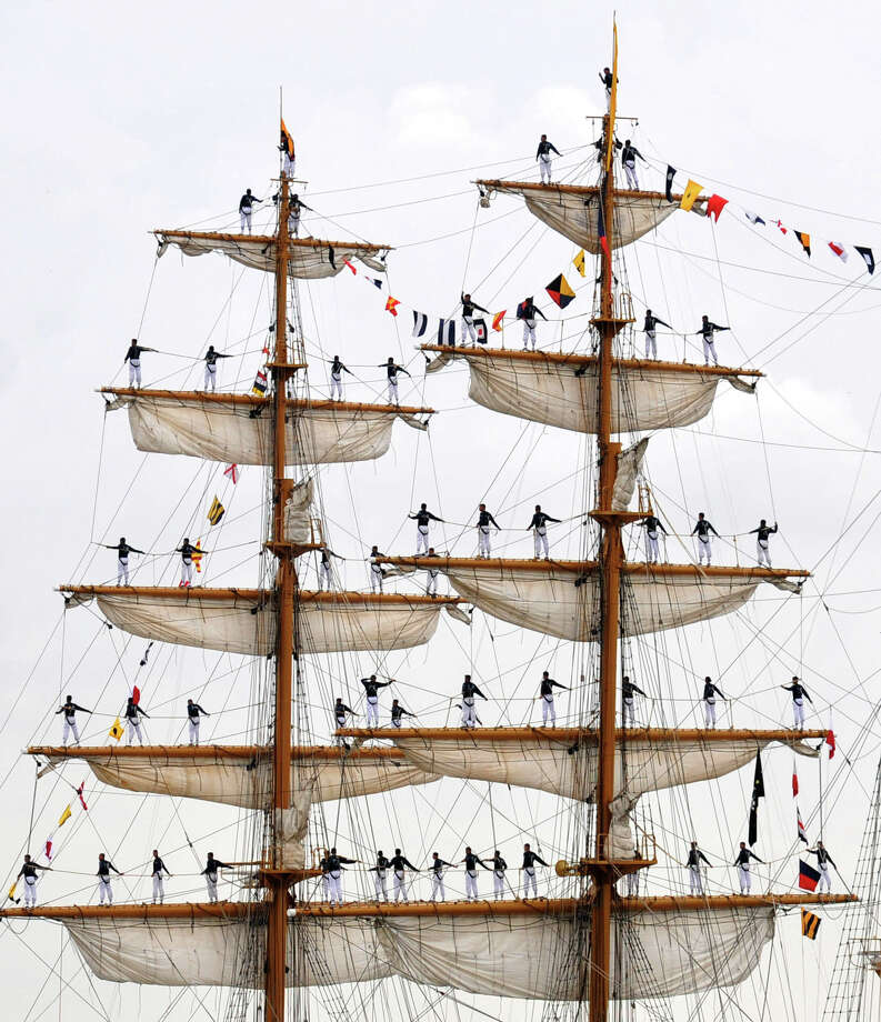In this photo provided by the U.S. Navy, Ecuadorian sailors of the Ecuadorian tall ship BAE Guayas man the yardarms as they arrive in New Orleans, Tuesday, April 17, 2012, in conjunction with The War of 1812 Bicentennial Commemoration in New Orleans. Photo: Kenneth W. Robinson, AP / Copyright 2012 The Associated Press. All rights reserved. This m