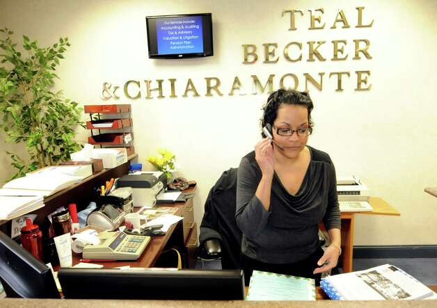 Receptionist Sherry Davis tends to business at the front desk on Thursday, March 15, 2012, at Teal, Becker & Chiaramonte in Albany, N.Y. The firm was voted a top place to work. (Cindy Schultz / Times Union) Photo: Cindy Schultz / 00016771A