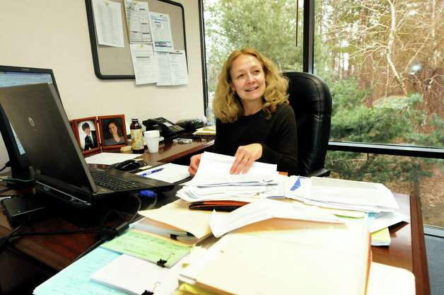 Partner Christine Oliver works in her office on Thursday, March 15, 2012, at Teal, Becker & Chiaramonte in Albany, N.Y. The firm was voted a top place to work. (Cindy Schultz / Times Union) Photo: Cindy Schultz / 00016771A
