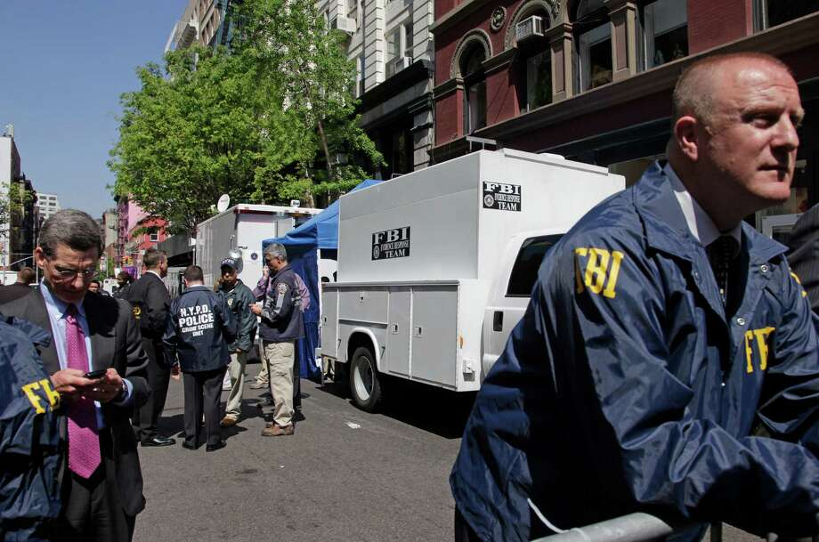 FBI and NYPD law enforcement officials search a SoHo basement at the corner of Wooster and Prince streets for the possible remains of missing child Etan Patz on Thursday, April 19, 2012 in New York. Patz vanished in 1979 after leaving his family's SoHo home for a short walk to his school bus stop.  NYPD spokesman Paul Browne says the building being searched is about a block from where the family lived.  (AP Photo/Bebeto Matthews) Photo: Bebeto Matthews, Associated Press / AP