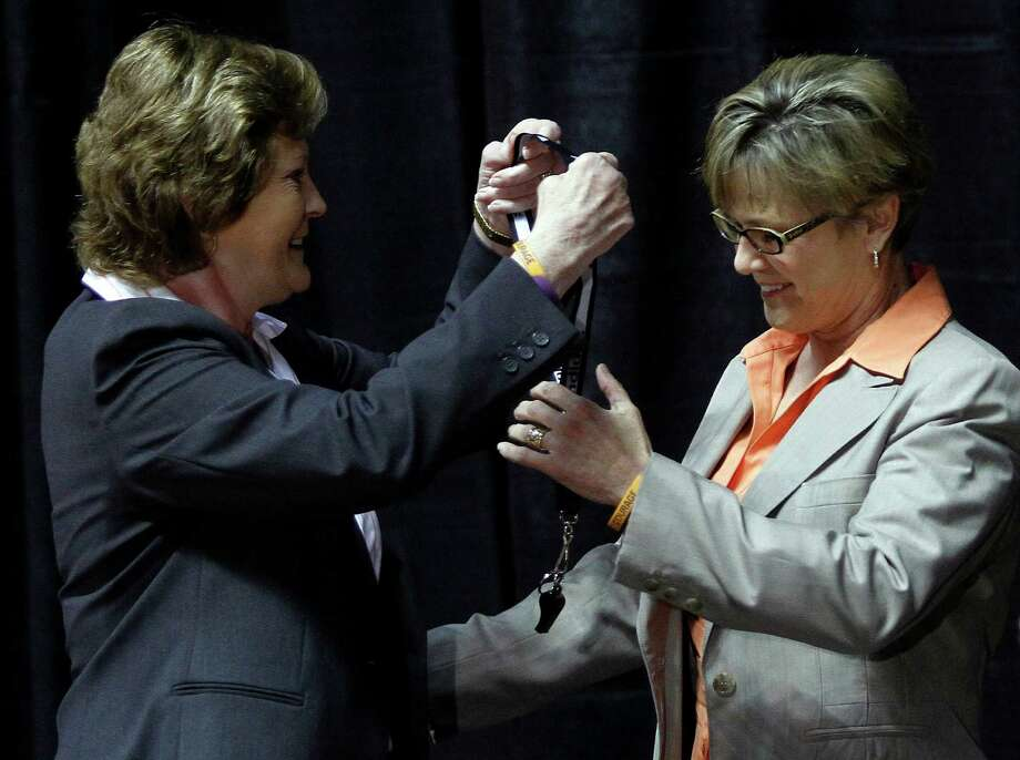 Former Tennessee women's basketball coach Pat Summitt (left) passes the whistle to new coach Holly Warlick. Photo: AP