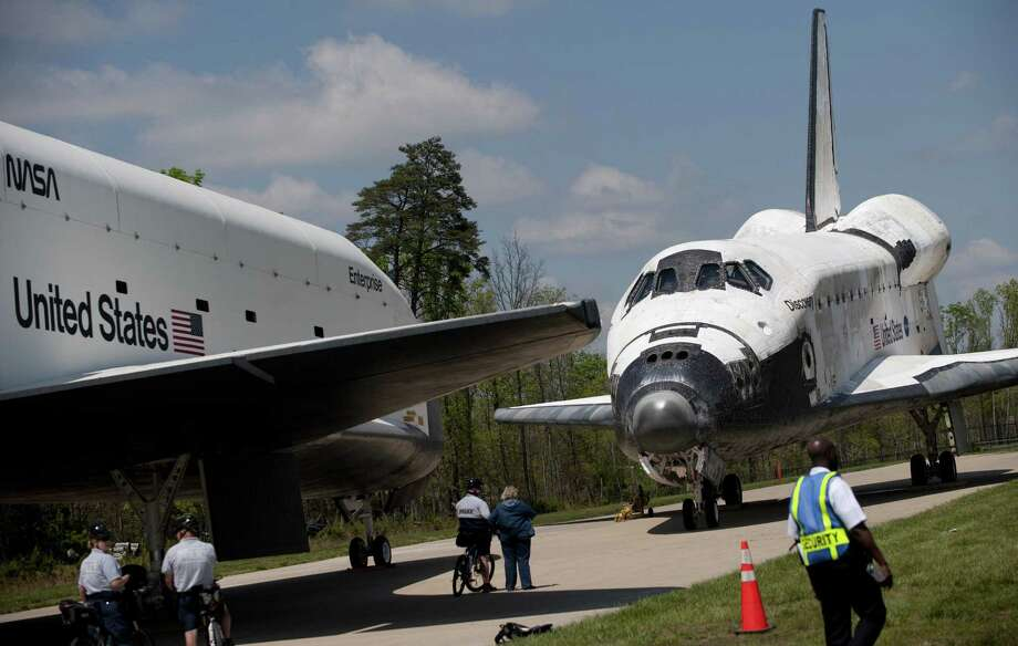 Space Shuttle Discovery and Space Shuttle Enterprise are parked nose to nose following a transfer ceremony at the Smithsonian National Air and Space Museum Steven F. Udvar-Hazy Center in Chantilly, Virginia, April 19, 2012. AFP PHOTO / Saul LOEB Photo: SAUL LOEB, AFP/Getty Images / AFP