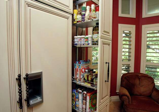 TASTE:   Pullout pantry in Sherry McCann's kitchen for Cooks & Cocinas, photographed Tuesday April 17, 2012.  Helen L. Montoya/San Antonio Express-News Photo: HELEN L. MONTOYA, San Antonio Express-News / ©SAN ANTONIO EXPRESS-NEWS