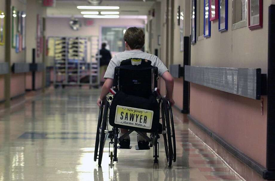 In this July 19, 2006 photo, Sawyer Rosenstein, 12, of Ramsey wheels down the hallway toward his room after undergoing physical therapy  at the Children's Specialized Hospital in Mountainside, N.J. A New Jersey school district has agreed to pay $4.2 million to settle a lawsuit by Sawyer Rosenstein, a middle school student who was paralyzed when a known bully punched him in the abdomen. Photo: Beth Balbierz, Associated Press