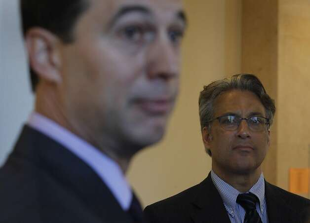 Ross Mirkarimi listens as his attorney Shepard Kopp responds after Judge Harold E. Kahn denied their request to remove City Attorney Dennis Herrera's office from the misconduct case against Mirkarimi, citing an alleged conflict of interest, at the Civic Center Courthouse in San Francisco, Calif. on Thursday, April 19, 2012. Photo: Paul Chinn, The Chronicle