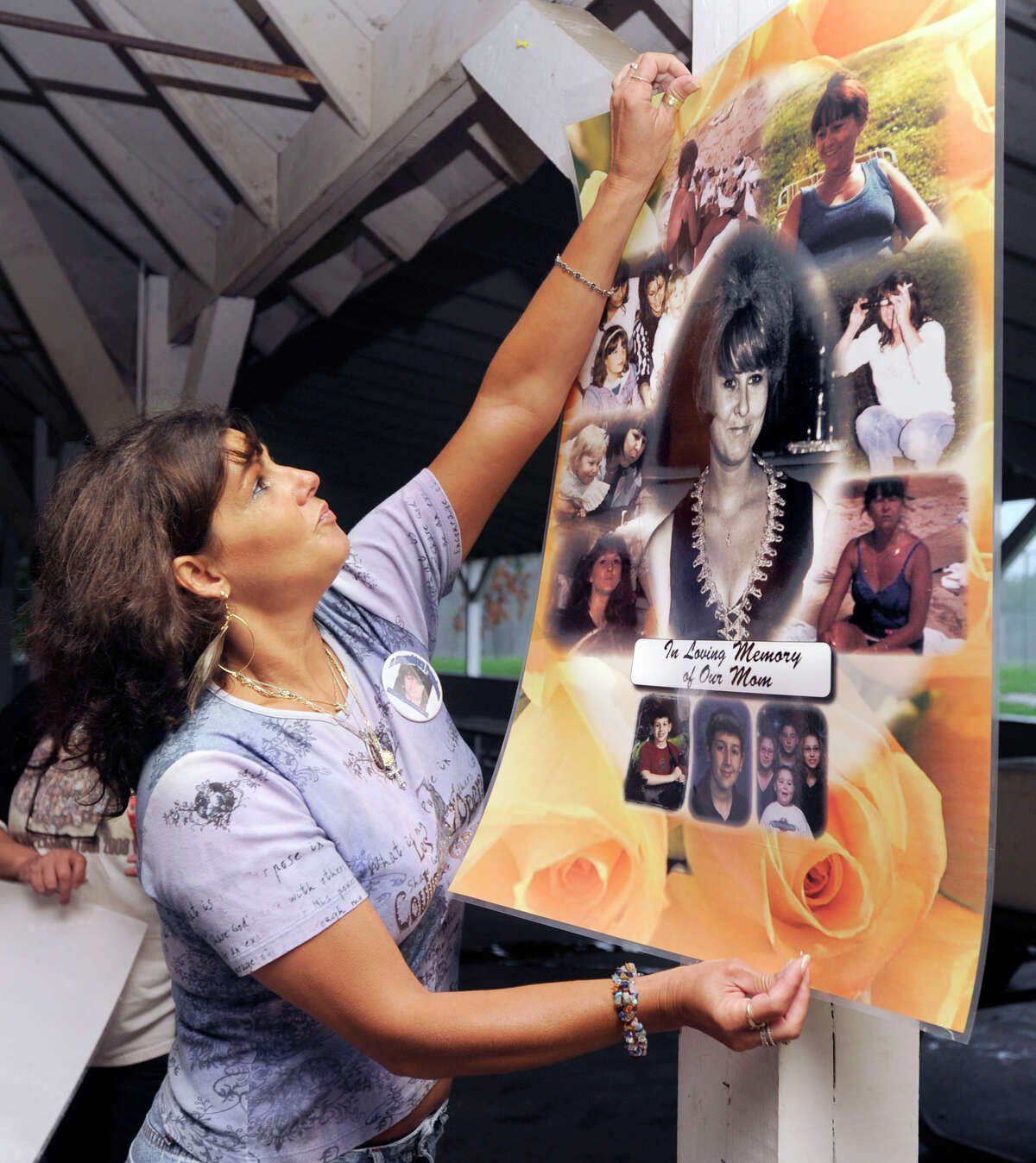 Beth Profeta, 46, puts up a poster remembering her mother Mary Badaracco who disappeared from her Sherman home 26 years ago. Sunday she and her sister Sherrie Passaro held a memorial to remember their mother along with other people that are also missing. Photo taken Sunday, August 22, 2010.