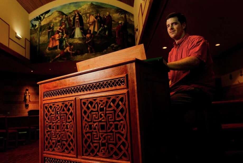 Ben Crandall, a Mormon, plays an organ at Saint Helen Catholic Church in Pearland. Photo: Mayra Beltran / © 2012 Houston Chronicle