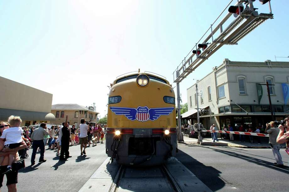 Union Pacific's vintage E-9 Streamliner diesel locomotive, a sleeker model that took over from the steam engines in the 1950s, made a stop at the New Braunfels Railroad Museum on Thursday, April 19, 2012 before continuing onto Sunset Station where it will be stationed until Sunday morning. Photo: HELEN L. MONTOYA, San Antonio Express-News / ©SAN ANTONIO EXPRESS-NEWS