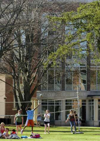 Students enjoy a sunny day on the campus Green at St. Rose College in Albany N.Y., Wednesday March 21, 2012. (Michael P. Farrell/Times Union) Photo: Michael P. Farrell