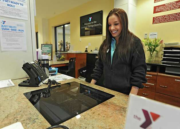 Member service representative Maegan Capron works on the computer at the front lobby desk in the Saratoga branch YMCA Thursday March 29, 2012 in Saratoga Springs, N.Y. (Lori Van Buren / Times Union) Photo: Lori Van Buren