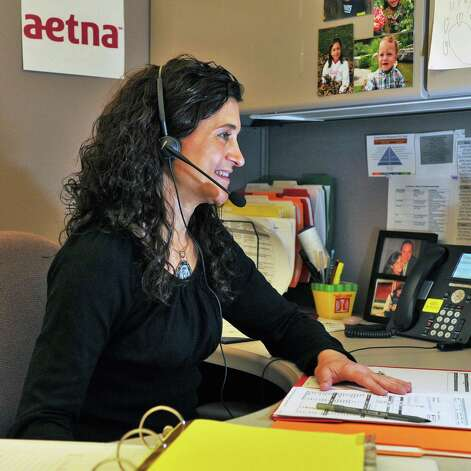 Health coach Lynette Panarese at the Aetna service center in Albany Thursday March 29, 2012.   (John Carl D'Annibale / Times Union) Photo: John Carl D'Annibale / 00017009A