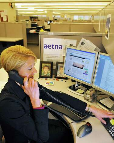 Health and wellness coach Kenly Brozman at the Aetna service center in Albany Thursday March 29, 2012.   (John Carl D'Annibale / Times Union) Photo: John Carl D'Annibale / 00017009A