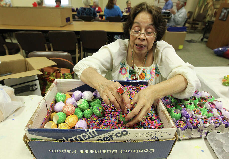 Volunteer Angelica Teneyuca places confetti inside of eggshells. Practically year-round, volunteers from the San Antonio Conservation Society spend their time on making cascarones and crepe paper flower decorations for Night in Old San Antonio (NIOSA). Photo: Kin Man Hui, Kin Man Hui/Express-News / ©2012 San Antonio Express-News