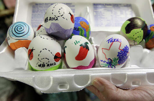 Around 200,000 eggs are made into cascarones each year by volunteers of the San Antonio Conservation Society. Though most of the cascarones are meant to be cracked over one's head, a small collection of hand-painted eggs are sold as souvenirs or memorabilia such as the ones shown in the photo. Practically year-round, volunteers from the San Antonio Conservation Society spend their time on making cascarones and crepe paper flower decorations for Night in Old San Antonio (NIOSA). On Thursday, Apr. 19, 2012, a group of volunteers arrived at Steves Homestead in King William to finish the last batches of cascarones and flowers for the start of the 2012 Fiesta season. Around 75 volunteers collectively made nearly 200,000 cascarones and over 12,000 paper flowers. The eggs are sold at NIOSA with proceeds going to the Conservation Society and their mission of historic preservation. The group which consists mostly women enjoyed chatting and shared a brunch while while they worked on the eggs and flowers. Kin Man Hui/Express-News. Photo: Kin Man Hui, Kin Man Hui/Express-News / ©2012 San Antonio Express-News