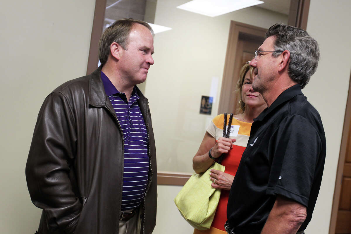 Head football coach Gary Patterson speaks with Dr. David Schmidt and his wife, Teresa, before a TCU boosters luncheon at Polo Fields Golf Center at Brackenridge Park, Thursday, April 19, 2012.