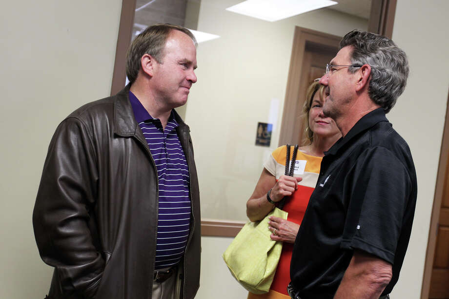 Head football coach Gary Patterson speaks with Dr. David Schmidt and his wife, Teresa, before a TCU boosters luncheon at Polo Fields Golf Center at Brackenridge Park, Thursday, April 19, 2012. Photo: JENNIFER WHITNEY, Jennifer Whitney/ Special To The Express-News / special to the Express-News