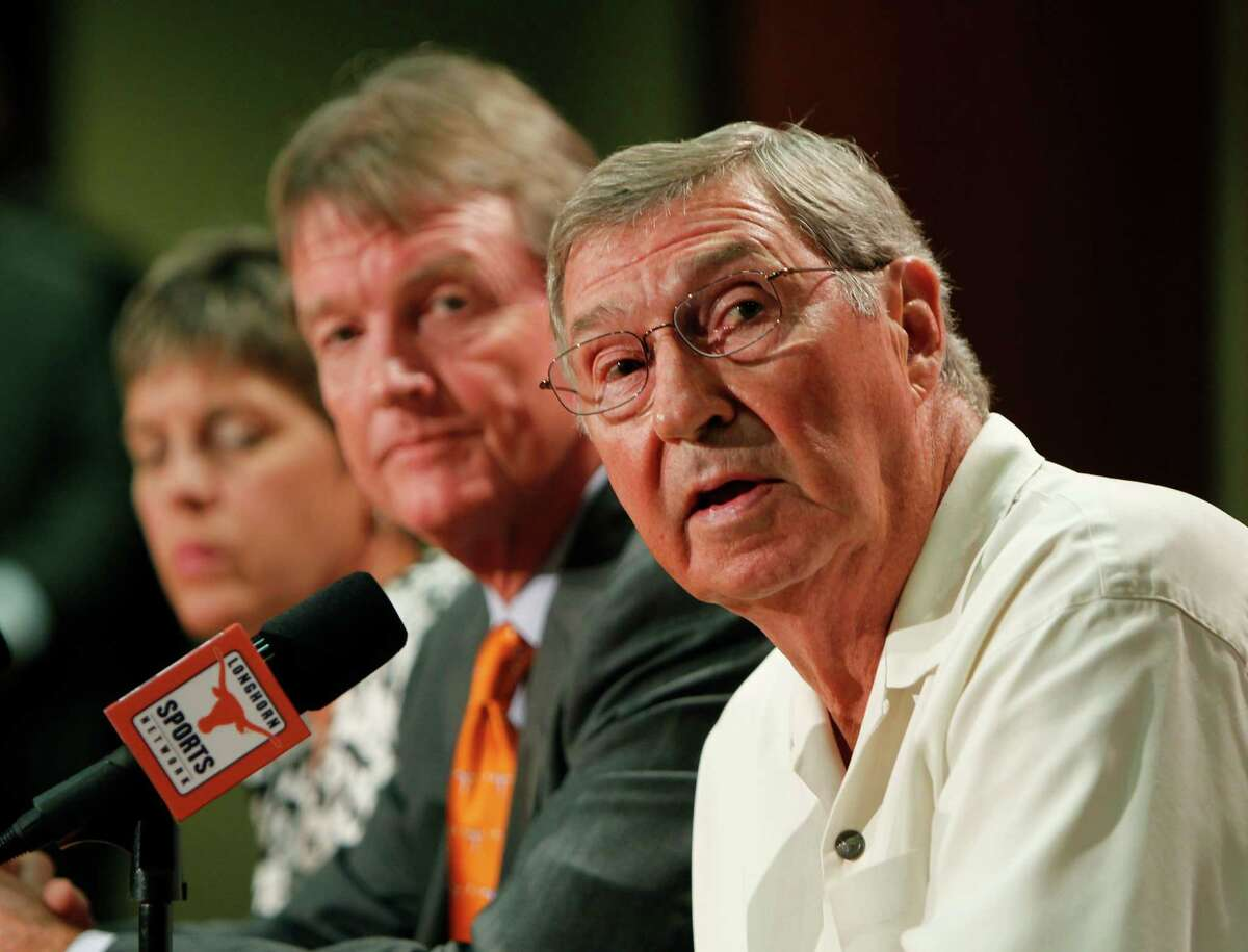University of Texas at Austin Men's Athletics Director DeLoss Dodds, right, University President William Powers Jr., center, and Women's Athletics Director Chris Plonskon announce the athletics programs will continue competing in the Big 12 Conference June 15, 2010 in Austin, Texas. (Photo by Erich Schlegel/Getty Images) *** Local Caption *** William Powers Jr.;DeLoss Dodds;Chris Plonskon