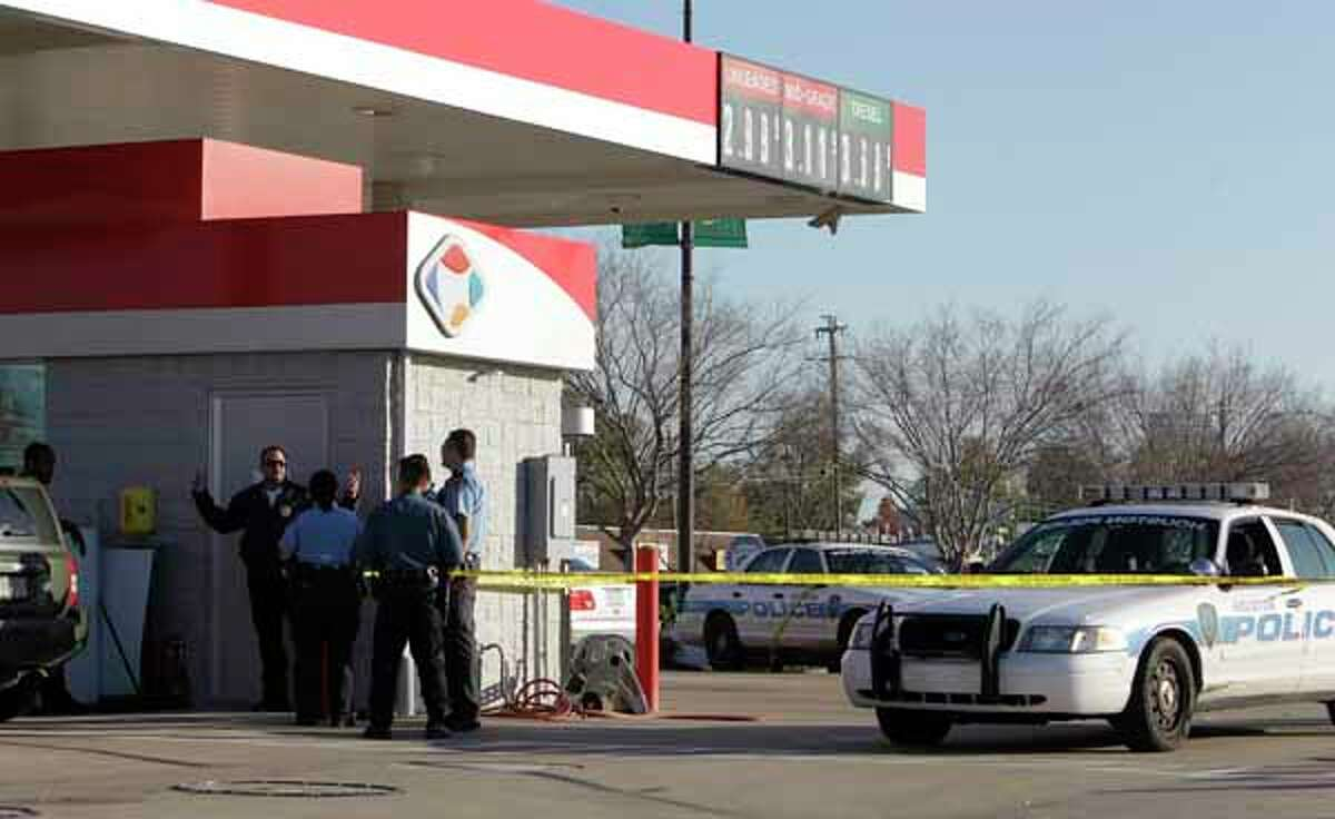 Houston police officers on the scene at the fuel center at Kroger, 1035 N. Shepherd Dr., where an armored van was stolen Tuesday, Dec. 27, 2011, in Houston. The armored van was located nearby at Colonial Apartments, 900 N. Durham.