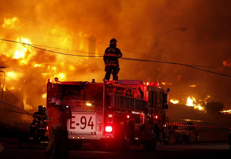 Firefighters battle a fire that destroyed an entire neighborhood on Claremont Drive in San Bruno in September 2010. The blaze was caused by a natural gas explosion at an underground PG&E pipeline. Photo: Brant Ward, The Chronicle