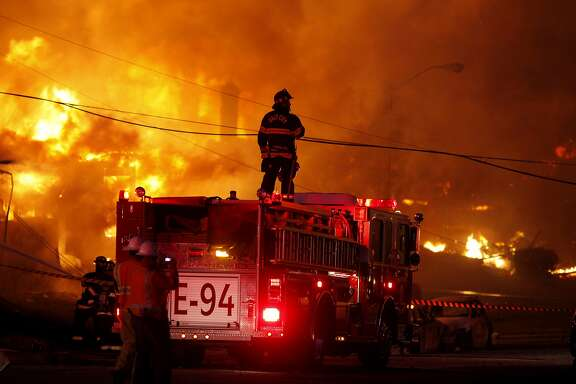Firefighters battle a fire that destroyed an entire neighborhood on Claremont Drive in San Bruno in September 2010. The blaze was caused by a natural gas explosion at an underground PG&E pipeline.