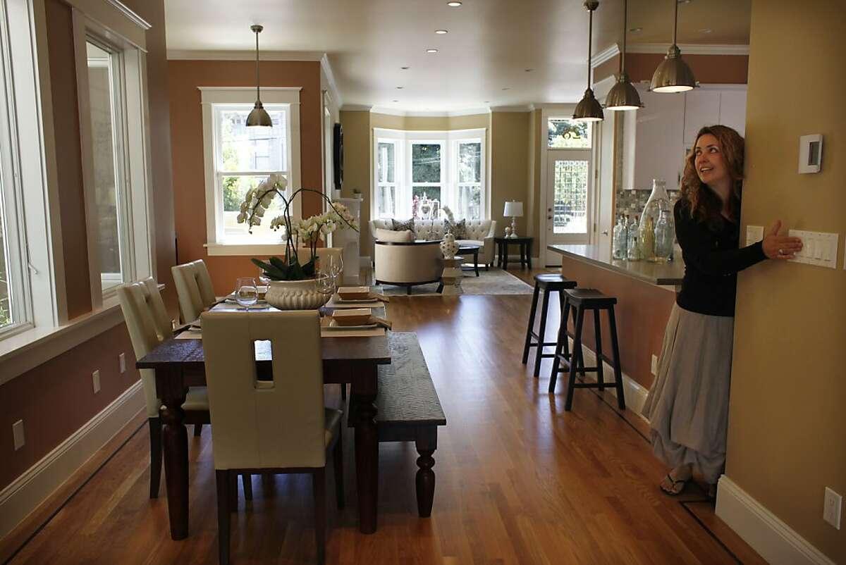 Renee Sullivan, co-owner of Bella Casa Home Staging, turns off lights after make adjustments in a home that was staged by Bella Casa Home Staging in Eureka Valley on Thursday, April 19, 2012 in San Francisco, Calif.