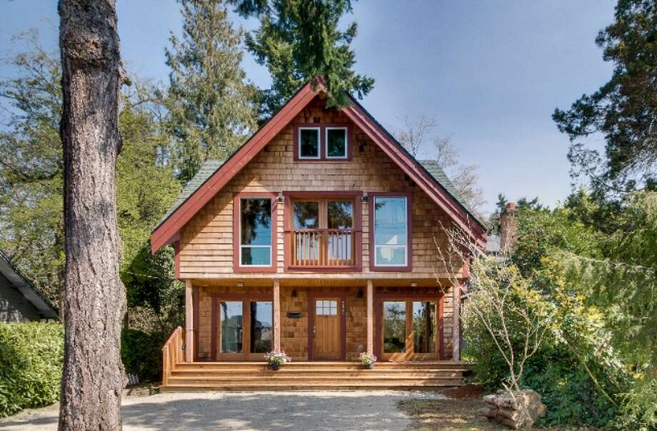 Here's your chance to own a unique, green, wood-filled house in West Seattle. The custom Northwest Contemporary home was built in 2006 at 7360 California Ave. S.W. It is 2,600 square feet, with three bedrooms and 2.5 bathrooms, including a master suite with a walk-in shower, vaulted wood ceilings with exposed beams, a loft and such green features as reclaimed wood, natural finish materials, high-efficiency radiant heating, Energy Star appliances and drought-tolerant landscaping on the 5,884-square-foot lot. It's listed for $730,000. Photo: Courtesy Eric Slawson/Keller Williams Realty