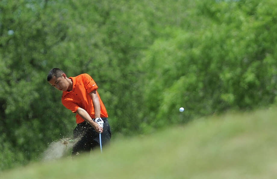 Gary Natal of New Braunfels Canyon hits a shot from the rough during the Region IV-4A boys golf championship at the Golf Club of Texas on Thursday, April 19, 2012. Photo: BILLY CALZADA, San Antonio Express-News / SAN ANTONIO EXPRESS-NEWS
