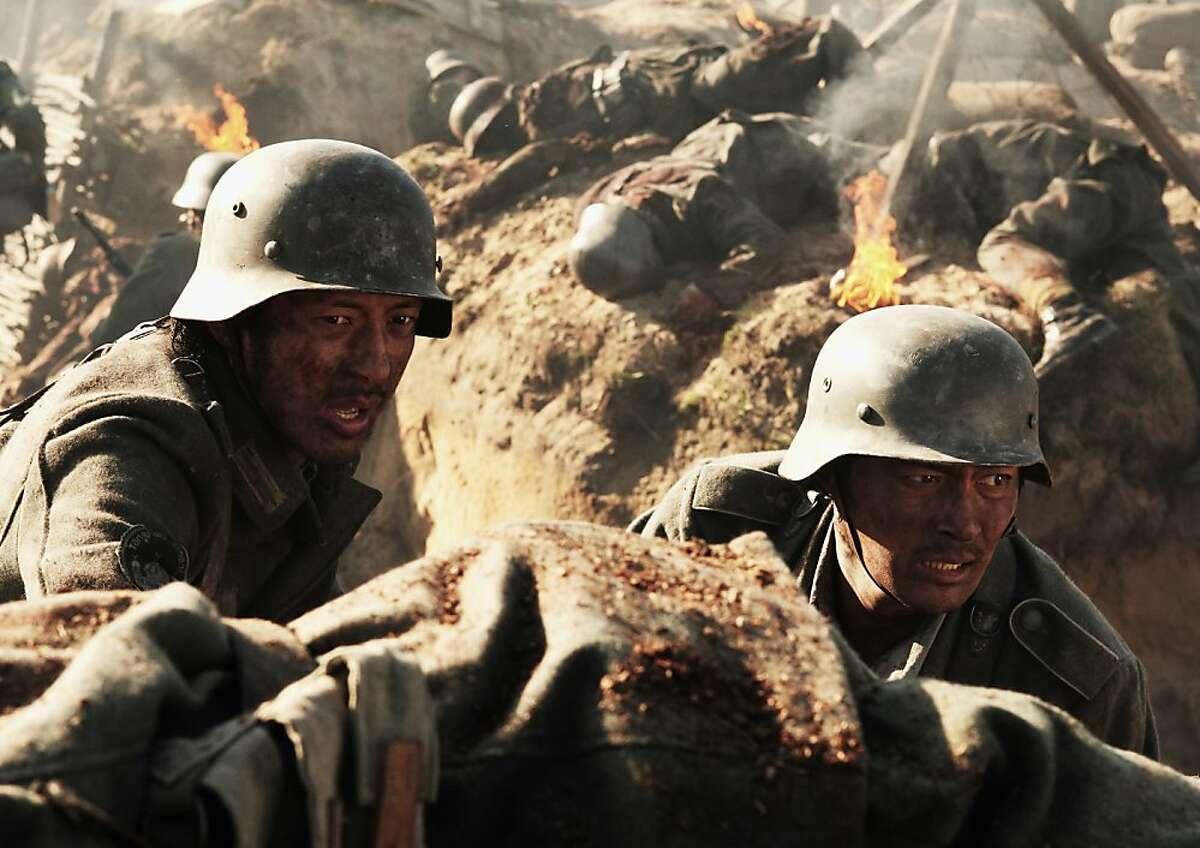 Joe Odagiri, left, and Jang Dong-gun appear in a scene from,