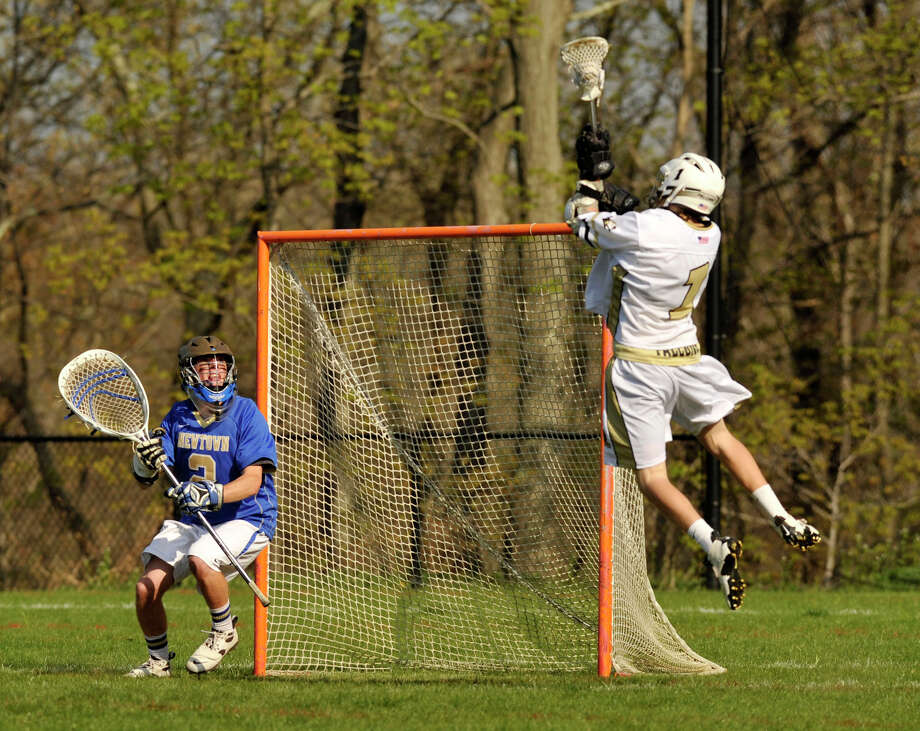 Joel Barlow's Liam Rooney leaps to receive a pass then shoots and scores on Newtown goalie Evan Isaacs during their game at Joel Barlow High School in Redding on Thursday, April 19, 2012. Joel Barlow won 17-4. Rooney led Joel Barlow with 5 goals. Photo: Jason Rearick / The News-Times