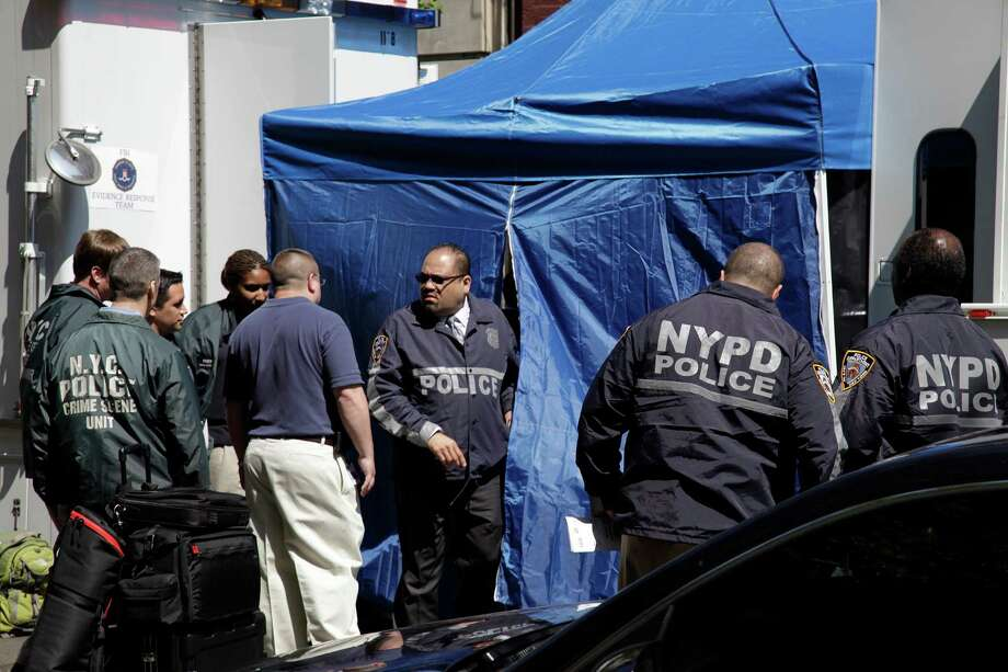 FBI and NYPD law enforcement officials search a SoHo basement for the possible remains of missing child Etan Patz who vanished in 1979. Photo: Bebeto Matthews / AP