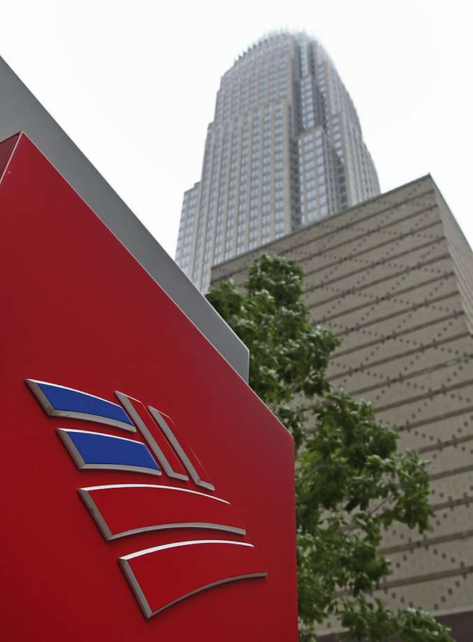 Bank of America's corporate headquarters is shown in Charlotte, N.C., Thursday, April 19, 2012. Bank of America said Thursday that it set aside less money to cover bad loans in the first three months of the year than it has since before the 2008 financial crisis. The bank said it earned $653 million in the first quarter, or 3 cents per share. (AP Photo/Chuck Burton) Photo: Chuck Burton, Associated Press